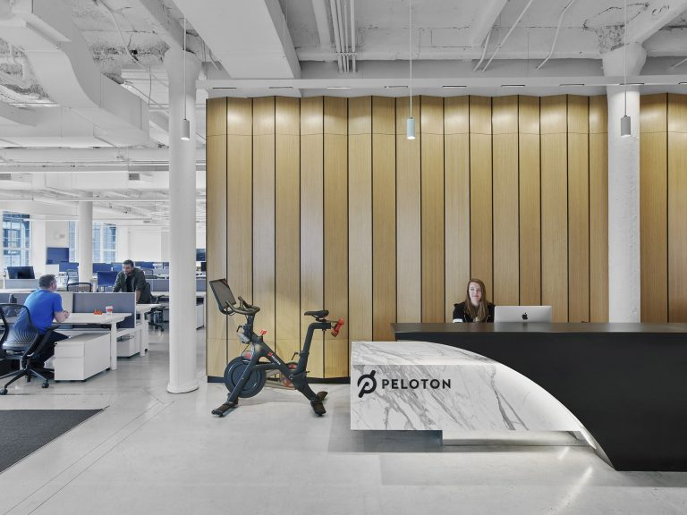 Custom reception and reception desk at Peloton's First Headquarters