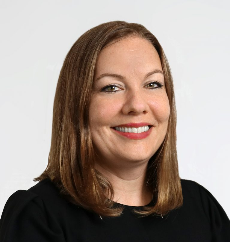 Professional headshot of Jessica Mann-Amato, IIDA
