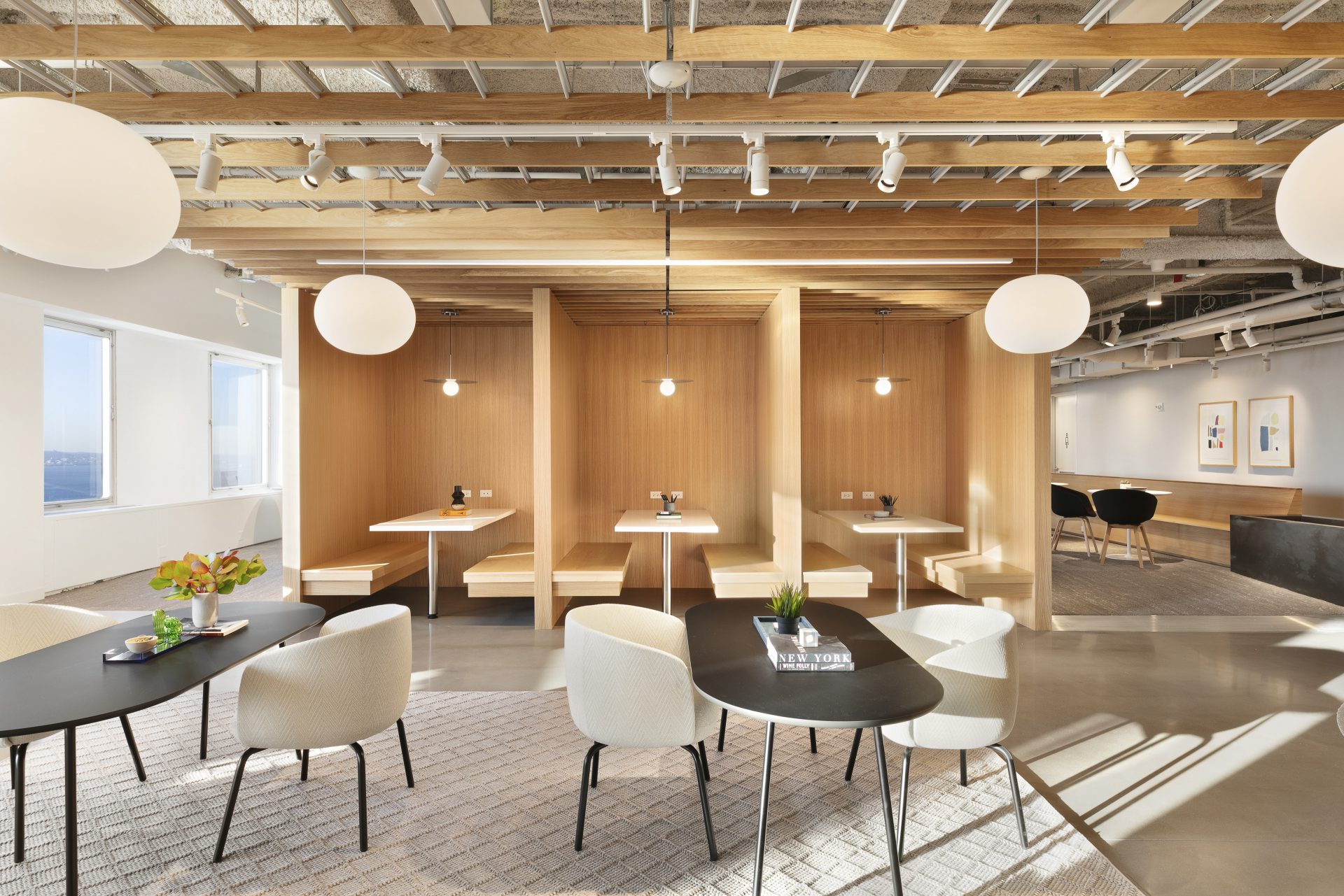 Open seating within The Village at One New York Plaza by Brookfield and Convene